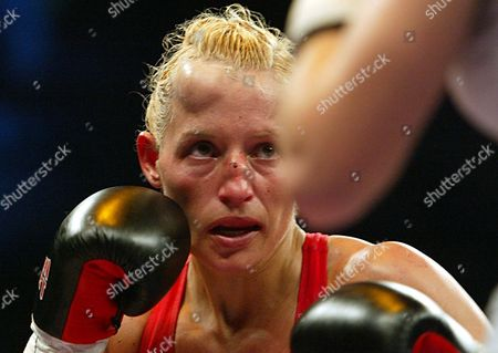 Junior Bantamweight Boxer Daisy Lang is Still on Her Feet in the 10th Round in Bayreuth Germany on Saturday 15 November 2003 Despite Her Badly Swollen Face But Lang Ultimately Lost Her Junior Bantamweight Title to Challenger and Fellow Bulgarian Galina Ivanova Gumliiska Germany Bayreuth