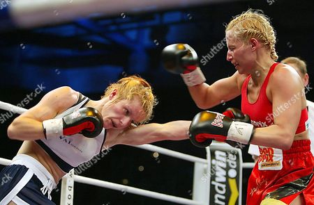 Junior Bantamweight Boxer Galina Ivanova Gumliiska (l) Lands a Punch on Defending Titleholder Daisy Lang in Bayreuth Germany on Saturday 15 November 2003 Lang Lost the Fight and Her Title to Fellow Bulgarian Gumliiska on Points Germany Bayreuth