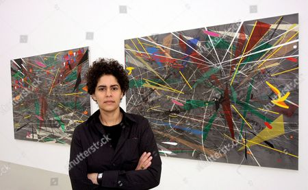 Ethiopian Artist Julie Mehretu Poses in Front of Her Artwork at the Art Club (kunstverein) in Hanover Germany Thursday 08 February 2007 Her Paintings Ought to Remind of Satellites' Images of the Earth the Exhibition Presents 18 Large-sized Works and Various Smaller Drawings Until 01 April According to the Museum It is Mehretu's First Solo Exhibition the 37-year-old Artist Lives in New York and Has Already Shown Her Works at the City's Museum of Modern Art As Well As at the Biennale of Both Istanbul and Sydney Germany Hanover