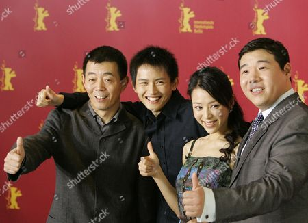 (l-r) Chinese Film Director Changwei Gu and the Chinese Actors Lu Yulai Zhang Jingchu and Feng Li Give a Thumbs Up As They Present Their New Film 'Peacock' at Ther Berlinale Filmfestival in Berlin Friday 18 February 2005 the Chinese Production Tells Story of Three People Whose Fates Each Represent a Human Extreme Against the Backdrop of the Period After the Cultural Revolution in China at the End of the 1970s Germany Berlin