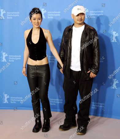 Chinese Actress Nan Yu and Filmmaker Quan-an Wang Pose at a Photo Call For Their Film 'Tuyas Marriage' at the 57th Berlinale Film Festival in Berlin Germany Saturday 10 February 2007 Germany Berlin