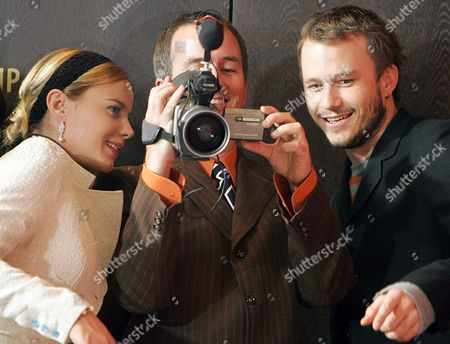 Australian Actor Heath Ledger (r) Australian Film Director Neil Armfield (c) and Australian Actress Abbie Cornish Smile As They Look Thorugh a Digital Camera During a Photocall For Their New Film 'Candy' at the 56th International Film Festival in Berlin Wednesday 15 February 2006 'Candy' Runs in Competition at This Year's Film Festival Germany Berlin
