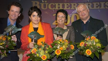 (from Left) Spanish Writer Yann Martel Turkish-born Author Yade Kara German Children's Book Author Mirjam Pressler and French Writer Eric-emmanuel Schmitt Hold Their German Book Awards During a Ceremony at the Book Fair in Leipzig on Thursday 25 March 2004 with More Than 2 000 Exhibitors From 29 Countries Numerous Events and Prominent German Authors the Leipzig Book Fair Which Opens 25 March is Hoping to Become a Major Player on the International Book Scene Germany Leipzig