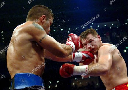 Hungarian Boxer Zsolt Erdei (r) Takes a Blow on the Chin From His Argentinian Opponent Hugo Hernan Garay During Their Wbo Middleweight Title Fight Held at the Hamburg Color Line Arena Germany Saturday 26 February 2005 Germany Hamburg