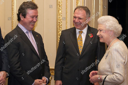 Queen Elizabeth II speaks to John O'Neill, Managing Director and Chief Executive Officer of Australian Rugby Union (left) and High Commissioner of Australia John Dauth