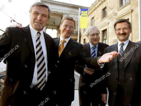 Friday 16 September 2005: Fdp Head of Fraction Wolfgang Gerhardt (l) Fdp Chairman Guido Westerwelle (2l) Fdp Financial Expert Rainer Bruederle (2r) and Hermann Otto Solms (r) Stand in Wiesbaden Just Before the Official Finale of the Fdp Election Campaign in Preparation For the General Elections on Sunday 18 September Germany Wiesbaden