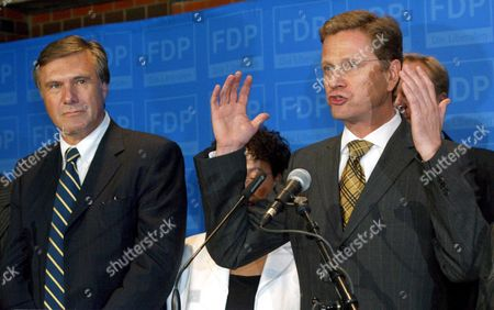 Guido Westerwelle (r) Chairman of the Liberal Democratic Party (fdp) Stand Next to the Chairman of the Fdp's Parliamentary Fraction Wolfgang Gerhardt As He Comments on the Election Results in the 2005 German Bundestag Election at the Fdp's Party Headquarter in Berlin Sunday 18 September 2005 Around 1 000 Supporters and Guest Joined the Election Party Germany Berlin