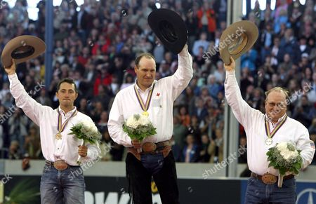 The Reining Riders Third-placed Us Aaron Ralston Winner Canadian Duane Latimer and Second-placed Us Tim Mcquay Wave Their Hats at the Victory Ceremony of the Reining Competition of the Fei World Equestrian Games in Aachen Germany Sunday 3 September 2006 the Fei World Equestrian Games End Today with the Finals of the Show Jumping Competition Germany Aachen