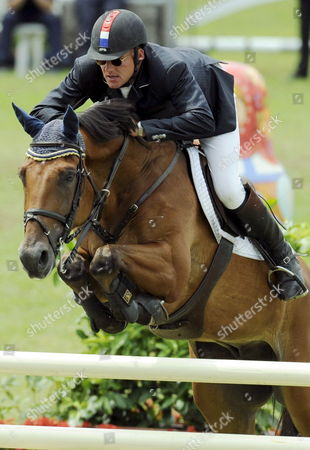 Dutch Show Jumper Albert Zoer Shown in Action on 'Sam' During the Grand Prix of Aachen at the Chio World Equestrian Festival in Aachen Germany 06 July 2008 Zoer Won the Grand Prix Ahead of the Germans Ludger Beerbaum on All Inclusive and Carsten-otto Nagel on Corradina Germany Aachen