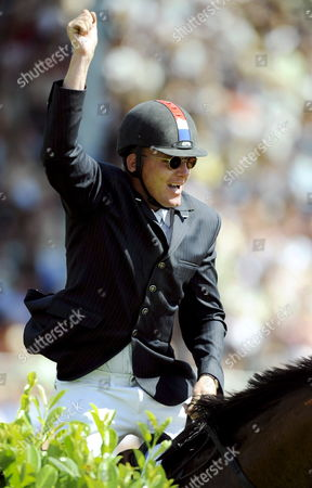 Dutch Show Jumper Albert Zoer Cheers on 'Sam' During the Grand Prix of Aachen at the Chio World Equestrian Festival in Aachen Germany 06 July 2008 Zoer Won the Grand Prix Ahead of the Germans Ludger Beerbaum on All Inclusive and Carsten-otto Nagel on Corradina Germany Aachen