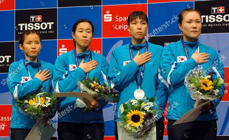 South Korean Women Foil Team (from Left) Nam Hyun-hee Hye Sun Lee Mi-jung Seo Und Kli-ok Jung on the Podium After Defeating Romania in the Foil Team Final at the Fencing World Championships in Leipzig Thursday 13 October 2005 Germany Leipzig