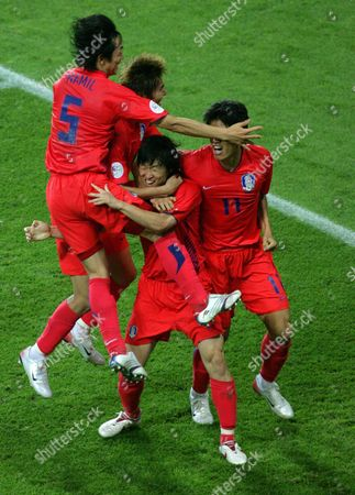 Korean Players Nam Il Kim (l-r) Dong Jin Kim and Ki Hyeon Seol (r) Celebrate the 1-1 Equalizer of Ji Sung Park (c) During Group G Preliminary Match of 2006 Fifa World Cup France Vs Korea Republic at the Fifa World Cup Stadium in Leipzig Germany Sunday 18 June 2006 Germany Leipzig