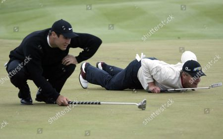 South Africa's Trevor Immelman (l) Lies on the Green with His Playing Partner Sweden's Joakim Haeggman During the Deutsche Bank-sap Open at St Leon-rot Germany on Sunday 23 May 2004 Some of the World's Best Golfers Are Competing For a Three Million Euro Prize in the Tournament Germany St Leon-rot