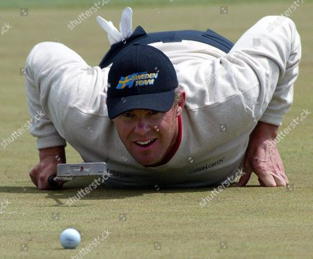 Sweden's Joakim Haeggman Lies on the Green During the Deutsche Bank-sap Open at St Leon-rot Germany on Sunday 23 May 2004 Some of the World's Best Golfers Are Competing For a Three Million Euro Prize in the Tournament Germany St Leon-rot