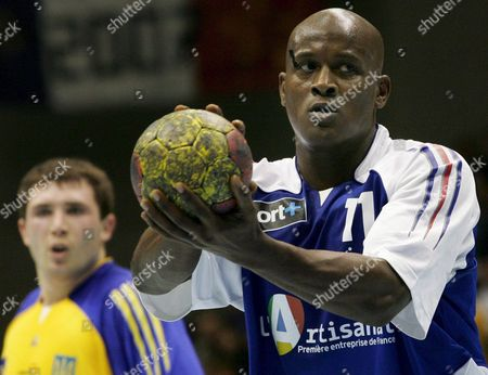 French International Olivier Girault (front) Concentrates Prior to a Penalty Throw During the Group B Preliminary Round Match Against Ukraine at the Handball World Championship at Boerdeland Hall in Magdeburg Germany Saturday 20 January 2007 Germany Magdeburg