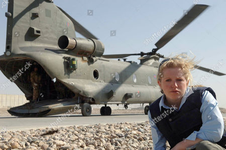 Journalist Kitty Dimbleby and the MERT helicopter at Camp Bastion