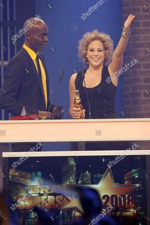 Stock Picture of German Singer Lafee (r) Receives a 'Golden Otto' Award From Tv Personality Bruce Darnell During the Bravo Supershow Television Show of Pro Sieben at the Arena in Nuremberg Germany 03 May 2008 the Readers of German Magazine For Young People Bravo Vote Their Favourites in the Otto Awards Germany Nuremberg