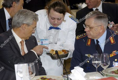 Stock Image of Spanish Defence Minister Federico Trillo Figueroa Y Martinez Conde (l) Sits Next to German General Harald Kujat Chairman of Nato's Military Committee at the Working Lunch of the Nato Defence Ministers in Munich Germany on Friday 6 February 2004 Defence Ministers From Nato's 19 Member States Meet in Munich For Talks on Expanding the Alliance Mission in Afghanistan and a Possible Role in Iraq the Meeting Takes Place on the Sidelines of the Annual Munich Security Conference Which Opens Saturday Germany Munich