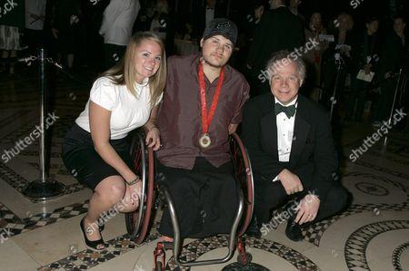 Nick Springer (centre), sister Olivia and father Gary Springer