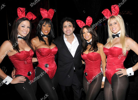 Stock Image of Palms Resort owner George Maloof and Playboy Bunnies at the Playboy Club in Las Vegas