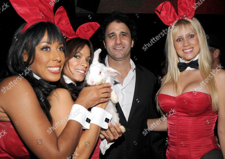 Palms Resort owner George Maloof and Playboy Bunnies at the Playboy Club in Las Vegas