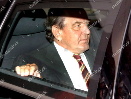 German Chancellor Gerhard Schroeder of the Social Democratic Party (spd) Leaves the Party Headquarters in a Car on His Way to an Exclusive Meeting with the Leader of the Cdu Angela Merkel and Edmund Stoiber Chairman of the Csu in Berlin Monday 10 October 2005 Germany Berlin