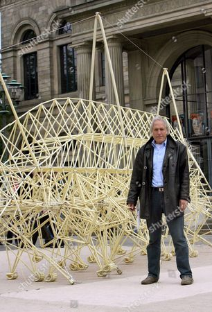 The Dutch Physicist and Artist Theo Jansen Stands in Front of His Sculpture 'Strandbeesten' in Front of the Opera in Hanover Germany 26 September 2007 the Sculpture Made of Installation Tubes and Rubber Hoses is Exhibited in Germany For the First Time Forming Part of an Exhibition of Jansen's Work of Arts in Hanover Germany Hanover