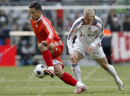 Sebastian Schweinsteiger (r) of Bayern Munich Challenges Du Zhen-yu of an Olympic Selction of China During a Friendly Soccer Match at the Allianz Arena in Munich Germany 12 January 2008 Germany Munich