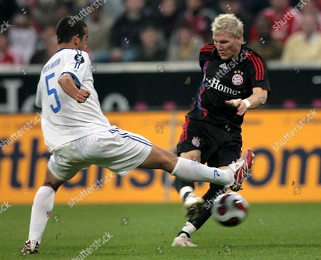 Bayern Munich's Sebastian Schweinsteiger (r) Struggles For the Ball with Belenenses Lisbon's Ruben Amorim During Their Uefa Cup First Round Soccer Match at the Allianz-arena in Munich Germany 20 September 2007 Germany Munich