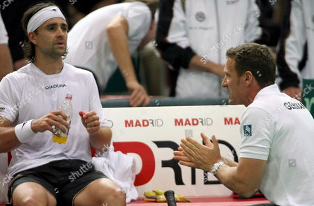 Germany's Team Captain Patrick Kuehnen (r) Talks with Nicolas Kiefer (l) in His Single's Match Against Rafael Nadal of Spain of the Davis Cup Quarter-finals Germany V Spain in Bremen Germany 11 April 2008 Germany Plays Spain For the Semi-finals From 11 to 13 April Germany Bremen