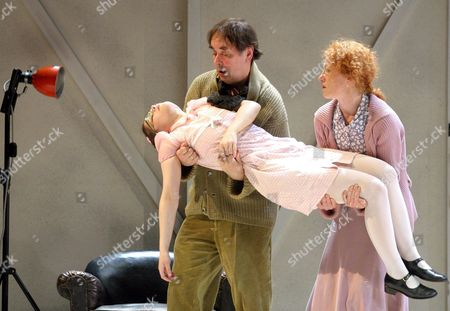 Stock Photo of Johann Adam Oest in Part of Hjalmar Ekdal (c) Ulrike Krumbiegel As His Wife Gina Ekdal and Christina Drechsler (front) in the Part of Daughter Hedvig Ekdal Perform a Scene From the Play 'The Wild Duck' by Henrik Ibsen During a Photo Rehearsal at the Berliner Ensemble (theatre) in Berlin Monday 10 May 2004 the Part of Gina Ekdal Marks Drechsler 'S First Major Part at the Berliner Ensemble Germany Berlin