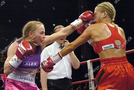 Germany's Regina Halmich (l) Delivers a Punch to Compatriot Daisy Lang During Their Iwbf World Championship Junior Bantamweight Fight in Kiel 29 May 2004 Halmich Won the Bout to Claim Her 45th Victory Germany Kiel