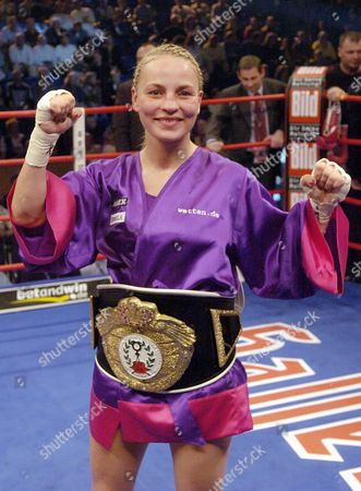 Germany's Regina Halmich Celebrates After Defeating Compatriot Daisy Lang in Their Iwbf World Championship Junior Bantamweight Fight in Kiel 29 May 2004 Halmich Won the Bout to Claim Her 45th Victory Germany Kiel
