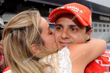 Brazilian Formula One Driver Felipe Massa (r) of Ferrari Receives a Kiss From His Wife Brazilian Anna Rafaela Bassi (l) After He Clocked the Fastest Time in the Qualifying Session at the Sepang Circuit Near Kuala Lumpur Malaysia 22 March 2008 the Formula One Grand Prix of Malaysia Will Take Place Here on 23 March 2008 Malaysia Sepang