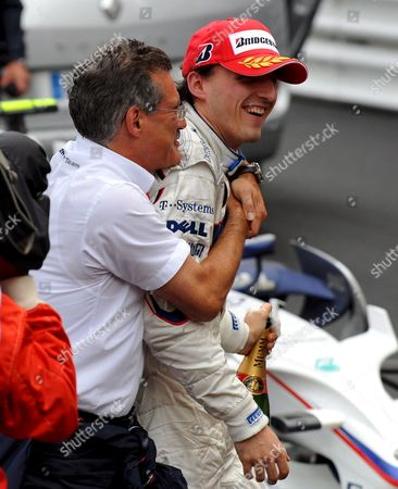Polish Formula One Driver Robert Kubica (r) of Bmw Sauber and German Dr Mario Theissen Motorsport Director of Bmw Sauber Celebrate After Kubica Finished Second in the F1 Grand Prix in Monte Carlo Monaco 25 May 2008 Monaco Monte Carlo