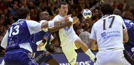 France's Nikola Karabatic (l) and Olivier Girault (2-l) Try to Stop Germany's Florian Kehrmann (c) and Andrey Klimovets (r) During Their Main Round Group 2 Match at the European Handball Championship in Trondheim Norway 23 January 2008 Norway Trondheim
