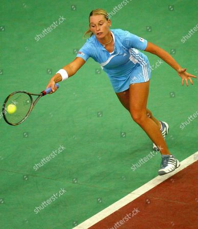 Stock Photo of Austrian Barbara Schett Returns the Ball to Her German Opponent Anna-lena Gronefeld During Their Match at the Wta Tennis Tournament in Leipzig Germany Tuesday 23 September 2003 Gronefeld Won 6-3 and 6-4 Epa Photo/dpa/florian Eisele// Germany Leipzig