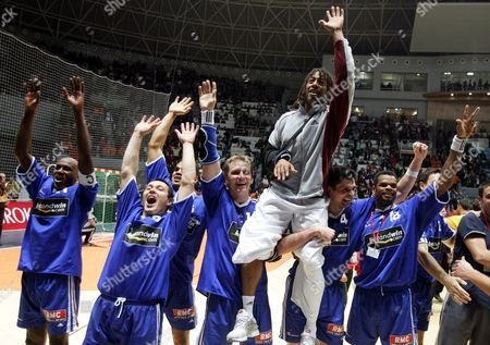 Olivier Girault Gregory Anquetil Daniel Narcisse Christophe Kempe Jackson Richardson Cedric Burdet and Joel Abati (l-r) of France Jubilate After They Won Their Match For Place Three Against Tunisia During the Handball World Championship Sunday 06 February 2005 in Rades Tunisia Richardson was Jinjured in the Semi-final Tunisia Rades