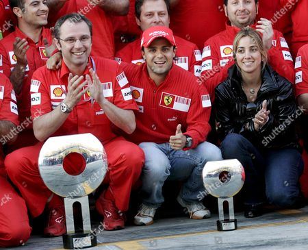 Brazilian Formula One Driver Felipe Massa of Ferrari (c) His Wife Rafaela Bassi (r) and Ferrari Sporting Director Stephano Domenicali Celebrate Their Victory with Team Members After Massa Won the Race at Istanbul Park Circuit in Istanbul Turkey on 11 May 2008 Turkey Istanbul