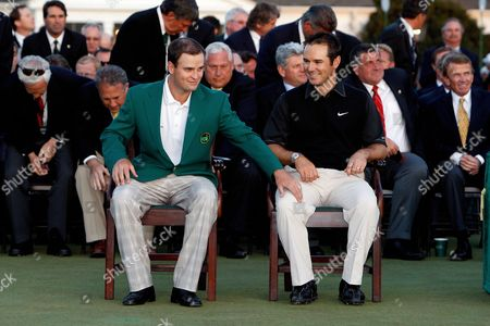 Zack Johnson of the U S (l the 2007 Masters Champion) Pats Trevor Immelman of South Africa on His Knee Before Helping Him Into His Traditional Champion's Green Jacket After Winning the 2008 Masters Tournament at Augusta National in Augusta Georgia Usa 13 April 2008 United States Augusta