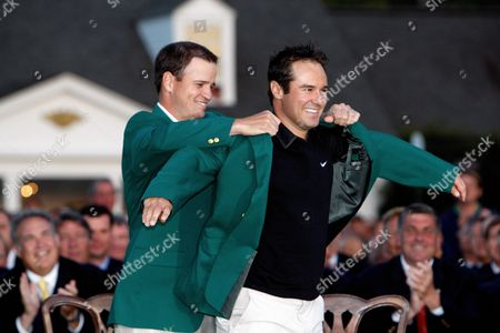 Zack Johnson of the U S (l the 2007 Masters Champion) Helps Trevor Immelman of South Africa Into His Traditional Champion's Green Jacket After Winning the 2008 Masters Tournament at Augusta National in Augusta Georgia Usa 13 April 2008 United States Augusta