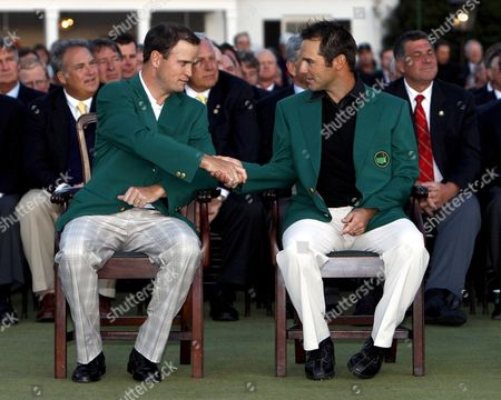 Zack Johnson of the U S (l the 2007 Masters Champion) Shakes Hands with Trevor Immelman of South Africa After Helping Him Into His Traditional Champion's Green Jacket After Winning the 2008 Masters Tournament at Augusta National in Augusta Georgia Usa 13 April 2008 United States Augusta