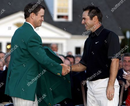 Zack Johnson of the U S (l the 2007 Masters Champion) Shakes Hands with Trevor Immelman of South Africa Before Helping Into His Traditional Champion's Green Jacket After Winning the 2008 Masters Tournament at Augusta National in Augusta Georgia Usa 13 April 2008 United States Augusta
