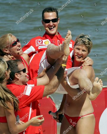 Formula One Ferrari Driver Michael Schumacher is Lifted in the Air by Australian Beach Volleyball Gold Medalists Natalie Cook (r) Kerri Pottharst and His Teammate Rubens Barrichello of Brazil (l) After a Beach Volleyball Game at St Kilda Beach Thursday 03 March 2005 in Melbourne Australia the First Grand Prix of the Season 2005 Will Start on Sunday 06 March 2005 Australia Melbourne