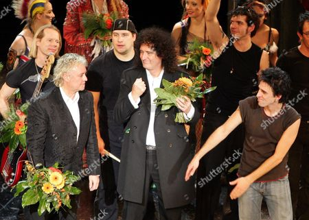 Stock Image of Queen Member Brian May (c) Roger Taylor (r) and Alex Melcher who Plays Galieo at the Premier of the Musical 'We Will Rock You' at the Musical Dome in Cologne on Sunday 12 December 2004 Germany Cologne