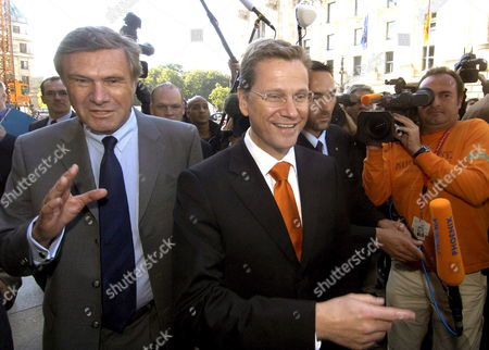Fdp Chairman Guido Westerwelle (r) and Fdp Head of Fraction Wolfgang Gerhardt Are Interviewed by Numerous Journalists in Front of the 'Haus Der Parlamentarischen Gesellschaft' in Berlin Germany Thursday 22 September 2005 Westerwelle Cdu Chairwoman Angela Merkel and Csu Chairman Edmund Stoiber Will Meet Here For First Exploratory Talks Germany Berlin