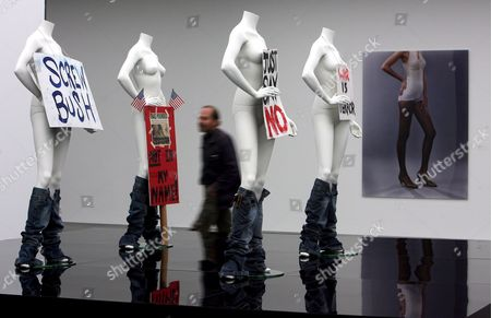 A Man Walks Past a 2007 Artwok by Josephine Meckseper Which Shows Mannequins Provided with Protest Signs at the Art Museum in Stuttgart Germany 12 July 2007 the 2006 Coupler-print 'Blow Up' is Seen in the Back the Museum Shows 150 Exhibits of the Artist From 14 July Until 28 October 2007 Germany Stuttgart