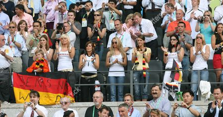 The Wives and Girlfriends of German Soccer Players Behind the Balustrade (l-r) Conny Lehmann with Son Behind the German Flag Unknown Woman Tina Girlfriend of Sebastian Kehl Monika Girlfriend From Lukas Podolski Sylwia Klose Petra Frings Lena Girlfriend of Tim Borowski and Simone Lambe (r) with Red Skirt During Group a Preliminary Match of 2006 Fifa World Cup Ecuador Vs Germany at the Olympic Stadium in Berlin Germany Tuesday 20 June 2006 Germany Berlin