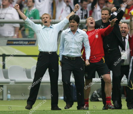 Stock Photo of German Team Coaches Juergen Klinsmann (l-r) Joachim Loew Andreas Koepke and Oliver Bierhof Celebrate During Penalty Shooting During the Quarter Final of the 2006 Fifa World Cup Between Germany and Argentina in the Olympic Stadium in Berlin Germany Friday 30 June 2006 Germany Berlin