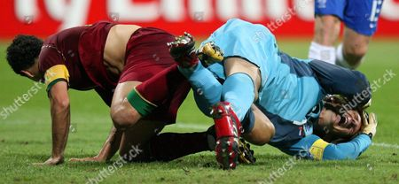 Dutch Goalkeeper Edwin Van Der Saar (r) Cries in Pain After a Tackle by Portuguese Simao Sabrosa (l) During the 2nd Round Match of the 2006 Fifa World Cup Between Portugal and the Netherlands in Nuremberg Germany Sunday 25 June 2006 Germany Nuremberg